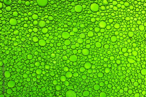 Leinwandbild Motiv Background of oil droplets on the water surface.
