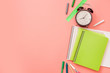 Colorful school supplies on pastel pink. Top view, flat lay. Space for text.