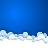 Blue sky with white paper decorative clouds.