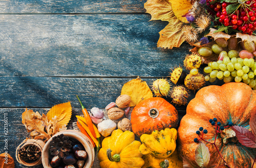 Happy Thanksgiving day concept - traditional holiday food with pumpkins on old wooden  - 221360711