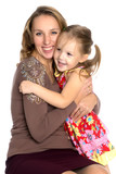 mother and little daughter gently embrace - 221364302