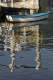Boat reflection anchored in the calm water - 221365939