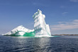 Iceberg in front of a rocky island, Newfoundland and Labrador, Canada