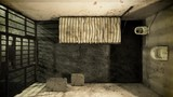 Top view of locked old prison cells with bed, sink, toilet and table. Dark atmosphere. Seamless looping animation. - 221369907