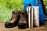 Hiking boots, backpack and map  on background - 221370137