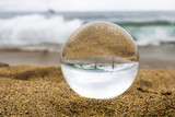 Children Play in Large Surf at Beach in Glass Ball - 221372504