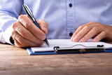 Businessman Signing Contract - 221374171