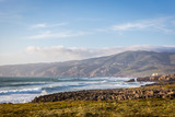 Amazing landscape scenario at the Guincho beach in Cascais, Portugal. Sunset colors, mountains, big waves. - 221376720