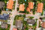 Vertical view from the air with vertical view of houses, roofs and streets of a village in northern Germany - 221383167
