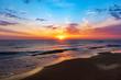 Leinwandbild Motiv Amazing colorful sunrise at sea