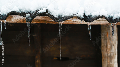 icicles on a wooden background place for text template for design