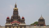 A close up of a palace rooftop containing many architectural domes in this static shot. - 221392139