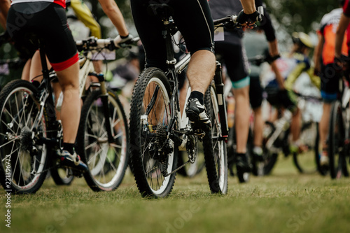 back group of cyclists mountain bikers in extreme sport race