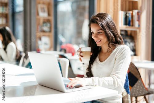 Sticker Brunette studying and enjoying coffee