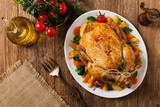 Roast chicken whole. Served on a plate with vegetables and baked potatoes. - 221401545