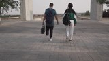 Young couple of break dancers walking in the park at sunset - 221413357