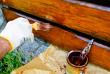painting a wooden fence - a brush close-up, a very shallow depth of field - 221413726