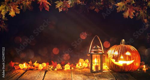 Leinwandbild Motiv Halloween pumpkin with lantern on wooden