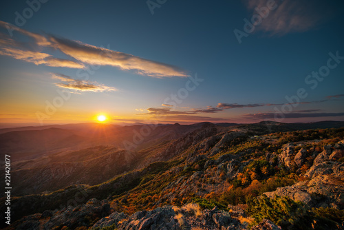 Foto Murales Beautiful sunset over the mountain hills and city, aerial panoramic view