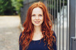 Leinwandbild Motiv Pretty young woman with gorgeous curly red hair