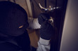 Leinwanddruck Bild - burglar breaking into the lock
