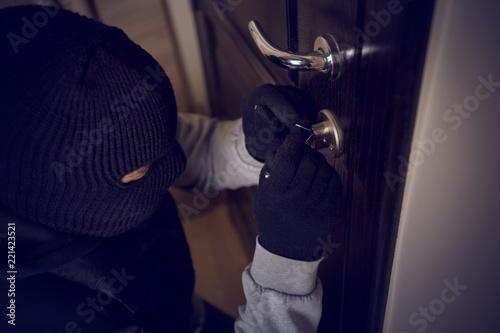 Leinwanddruck Bild burglar breaking into the lock