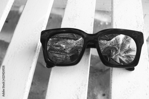 Sun glasses lying on a deckchair