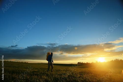 traveler sunset, man at sunset travels, extreme vacation, single tourism concept, trekking, landscape with man, beautiful sunset