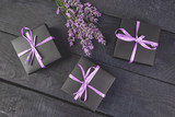 Black Gift box with violet ribbon and bouquet of flower - 221429503