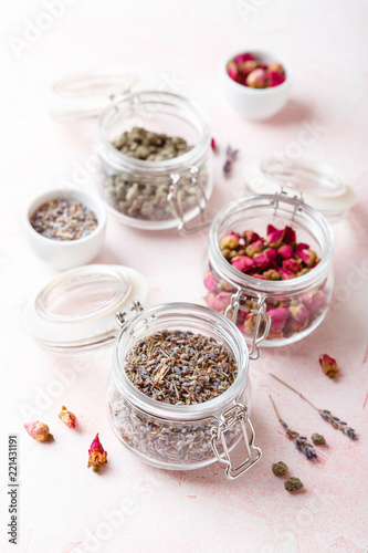 Dried rose flower buds and flowers in glass jars. Herbal tea, cleansing, organic bio products - 221431191