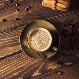 Green cup of coffee with beans and coffee mill on old wooden background. Top view. Retro style toned dark photography. - 221434171