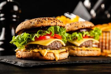 Delicious grilled burgers © George Dolgikh