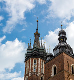 View of Medieval Cathedral Towers on blue Sky background - 221454326