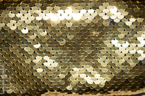 paillette sequins yellow gold color to decorate handbags clothes golden background shine for design backdrop © Вера Третьякова
