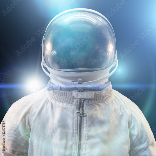 Cosmonaut or astronaut or spaceman suit and helmet with futuristic abstract blue lights on black background, close up