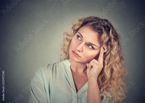 Dreaming thinking sad young woman