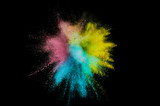 Colored powder explosion. Abstract closeup dust on backdrop. Colorful explode. Paint holi - 221480340