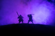 Leinwandbild Motiv Silhouette of two samurais in duel. Picture with two samurais and sunset sky