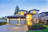 Grey luxury modern two story tall house exterior with stone columns - 221509361
