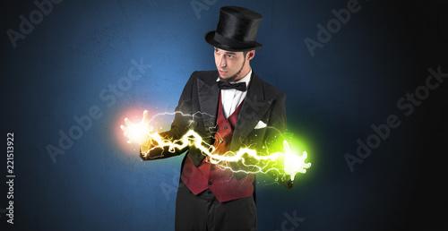 Leinwanddruck Bild Magician sparkling super power between his two hands