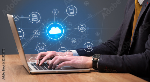 Leinwandbild Motiv Businessman hand typing with cloud technology system and office symbol concept