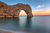 The Durdle Door, part of the Jurassic Coast in southern England, after sunset - 221532783