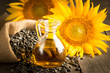 Leinwandbild Motiv Closeup photo of sunflower oil with seeds on wooden background. Bio and organic product concept.