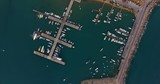 Aerial view of super yachts, sail boats and small water crafts moored in a marina - 221550380
