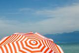 red white parasol on Lake Garda - 221552165
