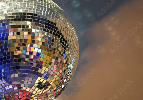 Shiny mirror ball with colorful highlights at the disco. - 221552711