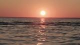 Slow motion handheld shot of waves at sunset - 221556126