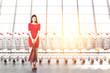 Leinwanddruck Bild - Woman with paper bags, row of supermarket trolleys