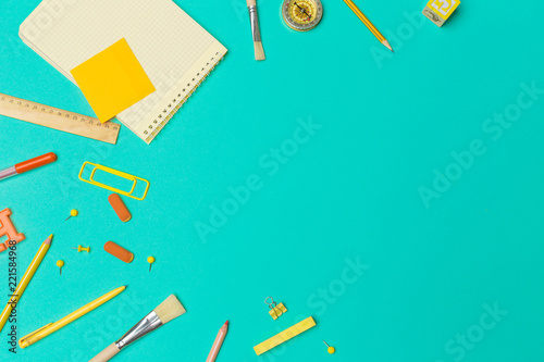 school supplies at colorful paper background © fotofabrika