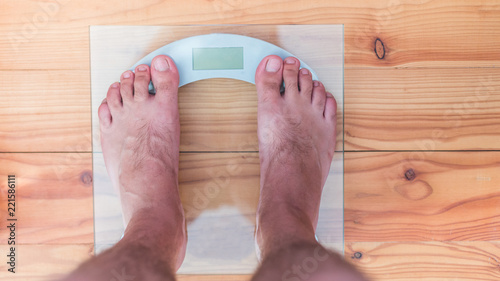 Male Bare Feet On Weight Scale